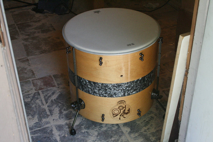 huge custom floor tom drum on the dirty shop floor