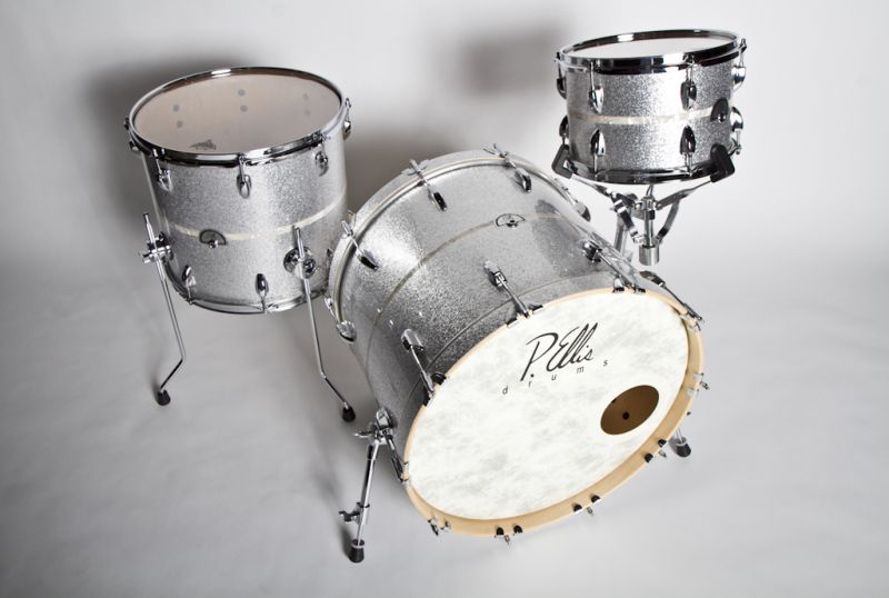 Stripped wrapped custom drum set with silver sparkle and aged white pearl