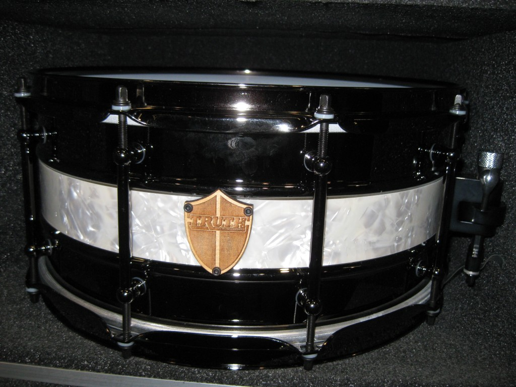 2 Metal snares cut and put together with a maple shell