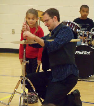 Ed Francis of Round Rock Drums having some one on one time with a student.