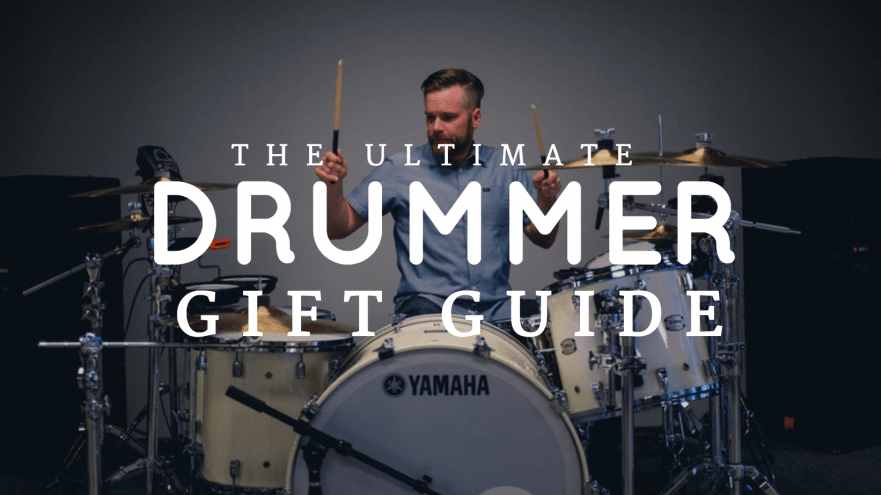 """A title slide with a picture of a drummer playing drums. The text says """"The ultimate drummer gift guide."""""""